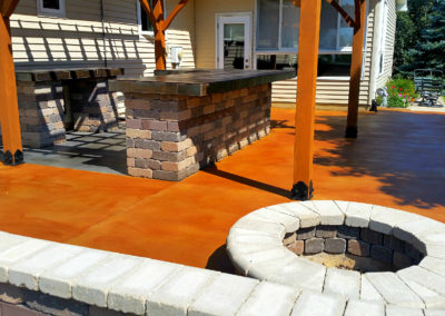amana-iowa-stained-patio-before-surecrete-eco-stain-acrylic-sealer-burnt-crimson-and-kayak-fire-pit