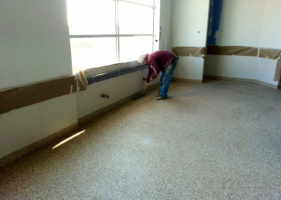 Institutional Flooring, Medical Facility Floor, one quarter inch Full Flake broadcast with epoxy base cove for sanitary cleaning purposes, dialysis treatment center floor
