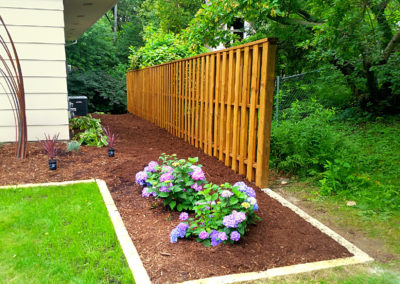 wiegand-fence-construction_seal-once_golden-oak_residential-wood-fence_quikrete_after