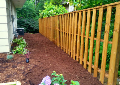 wiegand-fence-construction_seal-once_golden-oak_residential-wood-fence_quikrete_after-close-up